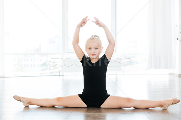 cute little girl ballerina doing twine in ballet school stock photo