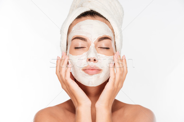 Woman with eyes closed and white facial mask on face Stock photo © deandrobot