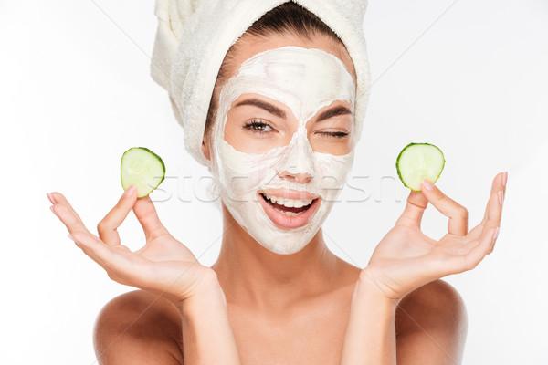 Jeune femme argile masque concombre tranches Photo stock © deandrobot