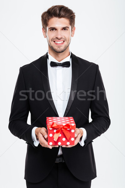 Businessman with gift Stock photo © deandrobot