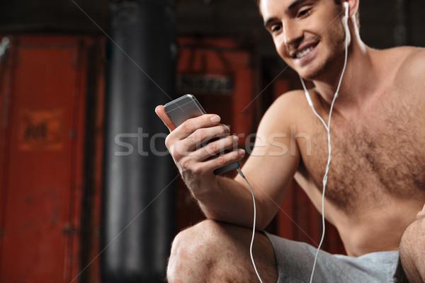 изображение счастливым человека спортзал слушать музыку Сток-фото © deandrobot