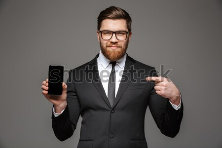 Young business man sniffing cocaine Stock photo © deandrobot
