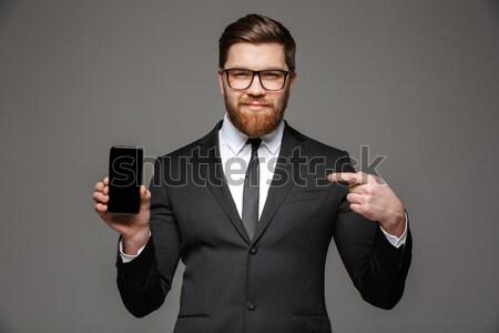 Jovem homem de negócios cocaína óculos terno preto isolado Foto stock © deandrobot