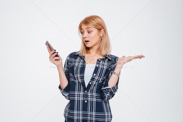 Foto stock: Surpreendido · mulher · jovem · telefone · foto · isolado