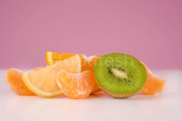 Sliced fresh peeled kiwi, lemon, tangerine and orange Stock photo © deandrobot