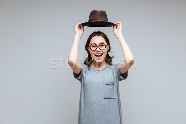 Riendo femenino nerd sombrero Foto stock © deandrobot