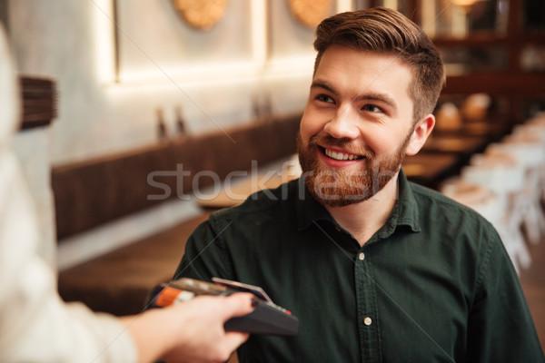 Bello giovani barbuto uomo seduta cafe Foto d'archivio © deandrobot