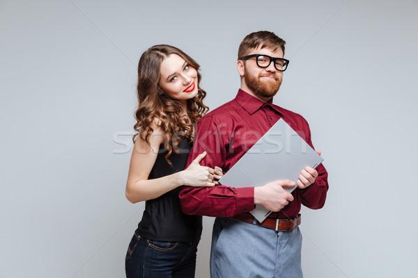 Sorrindo de volta masculino nerd óculos Foto stock © deandrobot