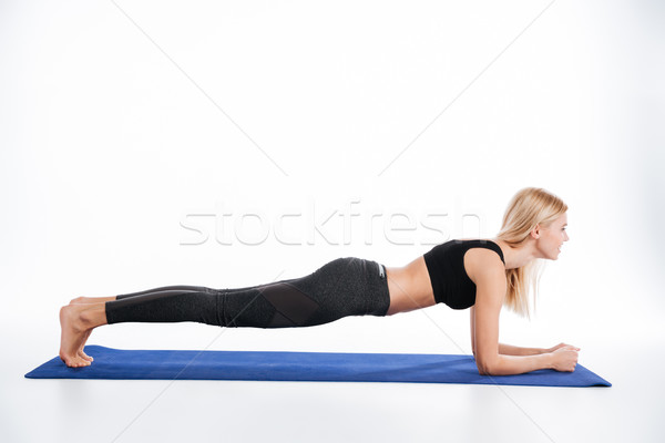 Concentrated fitness woman make sport exercises plank Stock photo © deandrobot