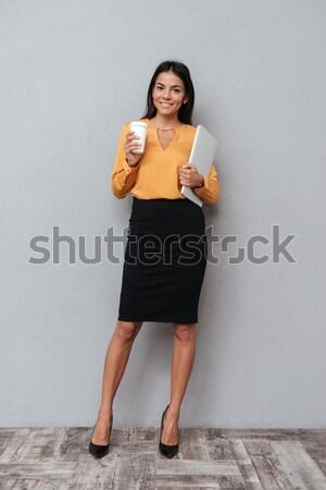 笑みを浮かべて 満足した ビジネス女性 ノートパソコン 徒歩 ストックフォト © deandrobot