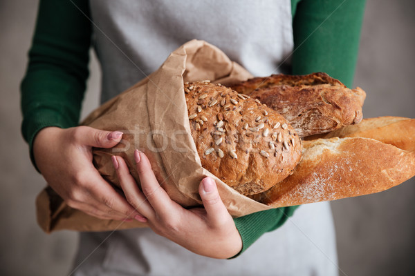 Közelkép fotó női pék tart táska Stock fotó © deandrobot