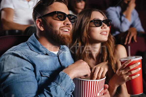 Concentrado amoroso Pareja amigos sesión cine Foto stock © deandrobot