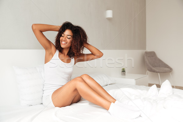 Shot jonge dame bed afrikaanse Stockfoto © deandrobot