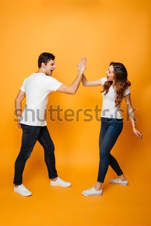Offended young loving couple swear isolated Stock photo © deandrobot