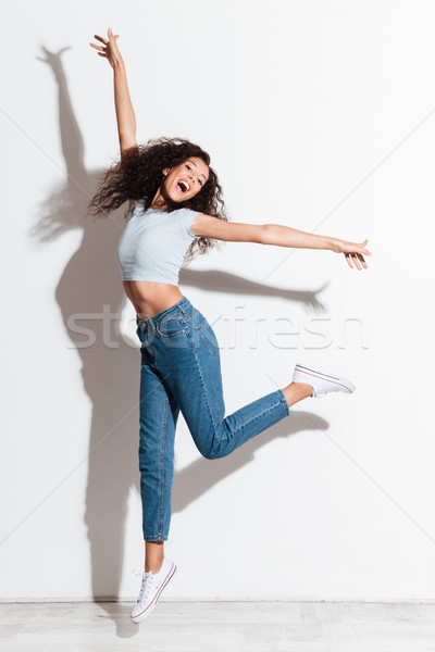 Coup sautant femme isolé heureux sourire Photo stock © deandrobot