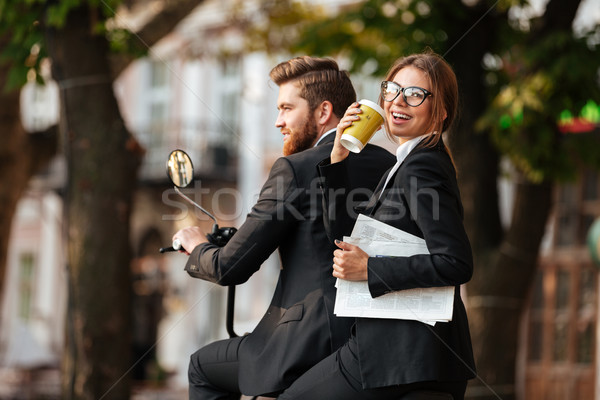 Back view of joyful elegant couple rides on modern motorbike Stock photo © deandrobot