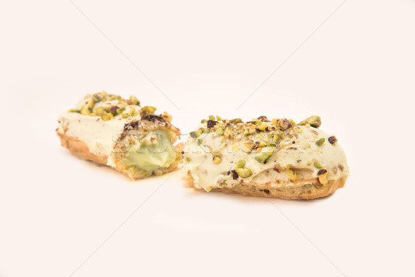 Close up of white eclair with nuts Stock photo © deandrobot