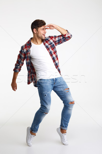 Full length portrait of a young casual man Stock photo © deandrobot