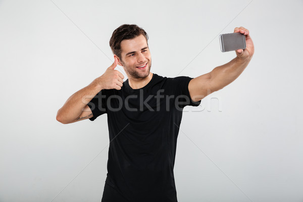 Stock photo: Happy sportsman make selfie by mobile phone.