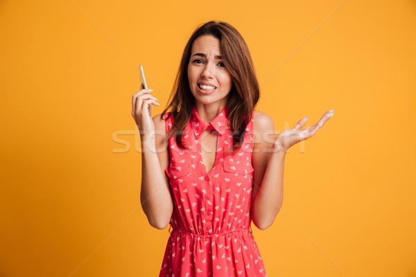 Jóvenes confundirse morena mujer vestido hablar Foto stock © deandrobot