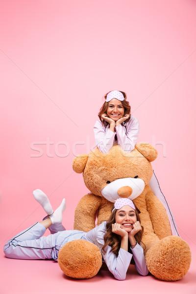 2 笑みを浮かべて 小さな 女の子 パジャマ 座って ストックフォト © deandrobot