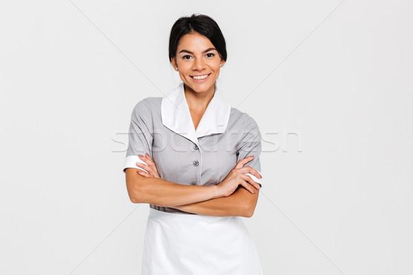 Közelkép portré fiatal mosolyog házvezetőnő egyenruha Stock fotó © deandrobot