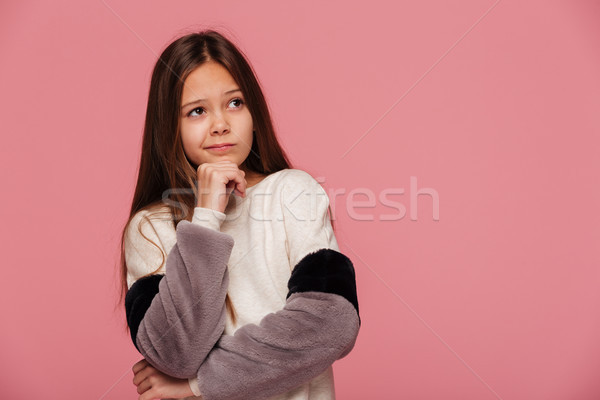 Displeased girl looking up at copy space isolated Stock photo © deandrobot