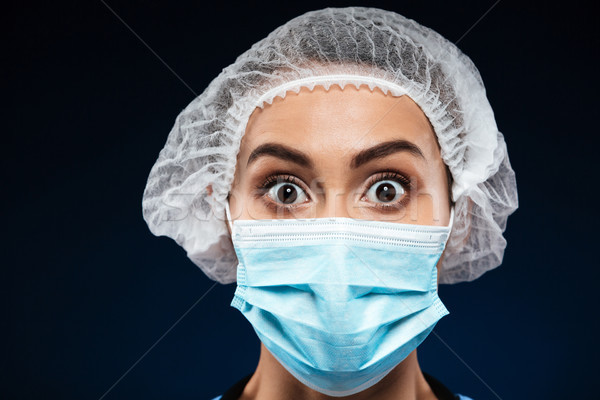 Portrait of shocked doctor looking camera isolated Stock photo © deandrobot