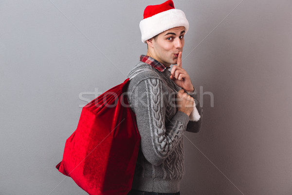 Side view of mystery man in sweater and christmas hat Stock photo © deandrobot