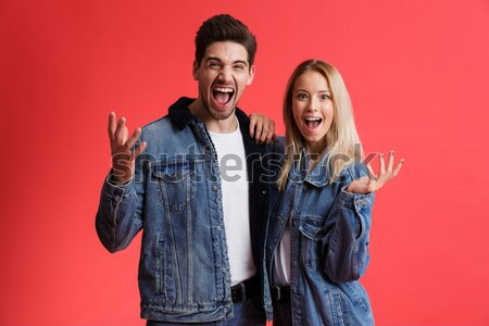 Funny cool punk couple hugging and looking at the camera Stock photo © deandrobot