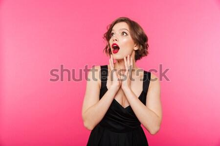 Retrato menina vestido preto jogar cabelo Foto stock © deandrobot