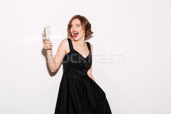 Portret dziewczyna czarna sukienka szampana odizolowany Zdjęcia stock © deandrobot
