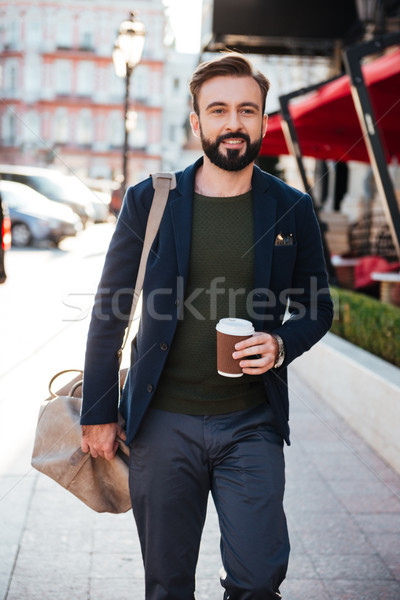 Portrait of a joyful attractive man drinking coffee Stock photo © deandrobot