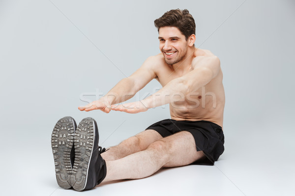Portrait of a smiling young half naked sportsman Stock photo © deandrobot