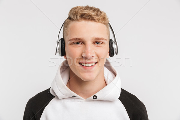 Portrait closeup of teenage boy 16-18 years old wearing hoodie a Stock photo © deandrobot