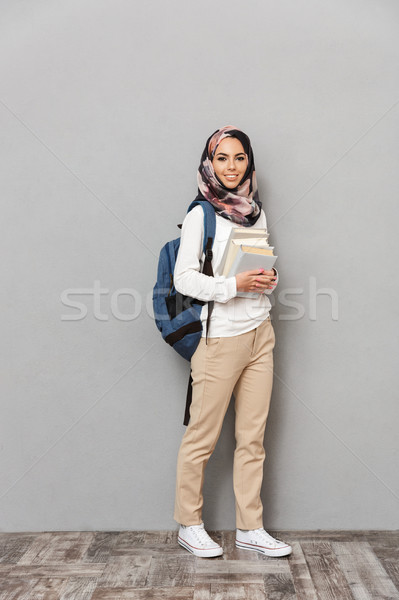 Full length portrait of a happy young arabian woman Stock photo © deandrobot