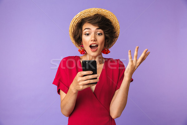Surprised Pretty brunette woman in dress and straw hat Stock photo © deandrobot