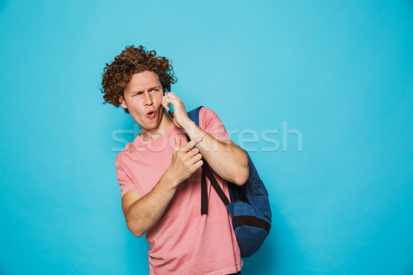 Photo of european college guy with curly hair wearing casual clo Stock photo © deandrobot