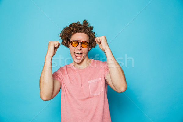 Portrait of fashion guy 20s with brown curly hair wearing modern Stock photo © deandrobot
