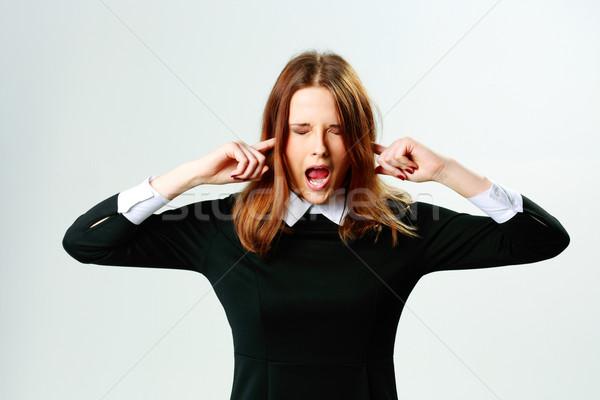 Jeune femme oreilles hurlant gris beauté Photo stock © deandrobot