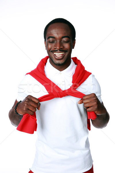Studio shot of a smiling african man over whtie background Stock photo © deandrobot