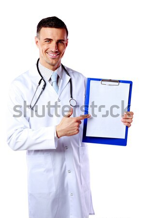 Disgruntled male doctor pointing at blank white paper over white background Stock photo © deandrobot