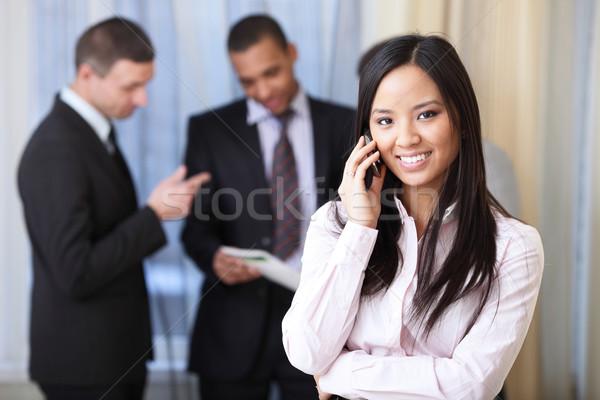 портрет молодые счастливым азиатских женщину телефон Бизнес-партнеры Сток-фото © deandrobot