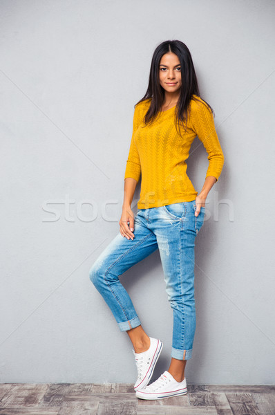 Trendy woman posingng on gray background Stock photo © deandrobot