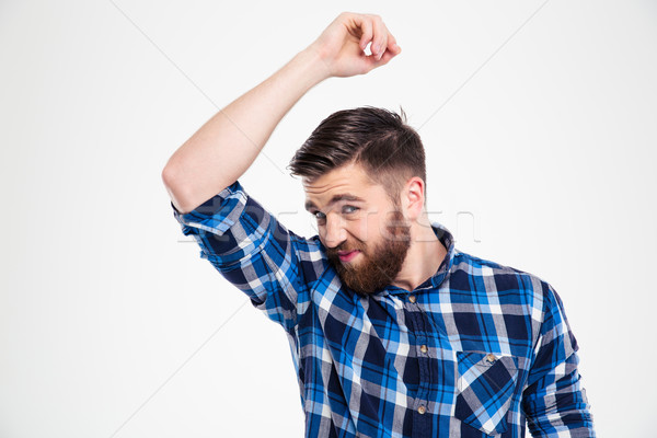 Portrait of a casual man smelling his armpit Stock photo © deandrobot