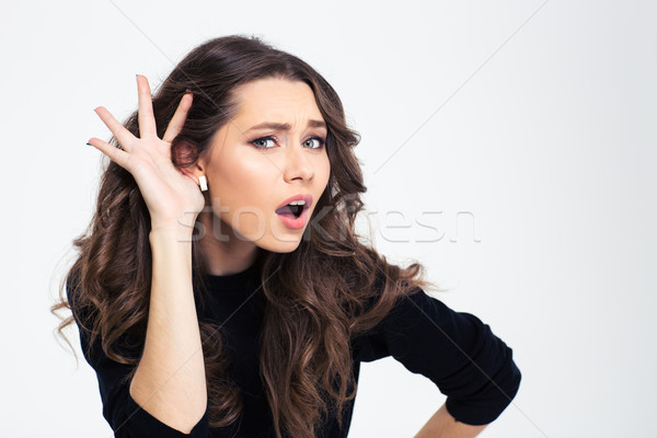 Girl with hand on ea Stock photo © deandrobot