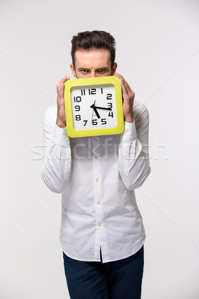 Zakenman gezicht muur klok portret geïsoleerd Stockfoto © deandrobot