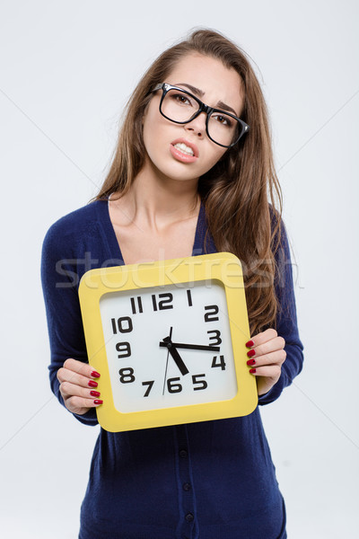 Portrait of a sad woman holding wall clock  Stock photo © deandrobot