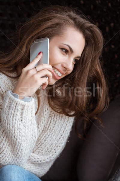 положительный женщины говорить сотового телефона улыбка красивой Сток-фото © deandrobot