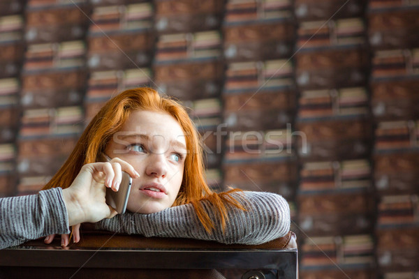 Pretty cute girl with red hair talking on mobile phone  Stock photo © deandrobot